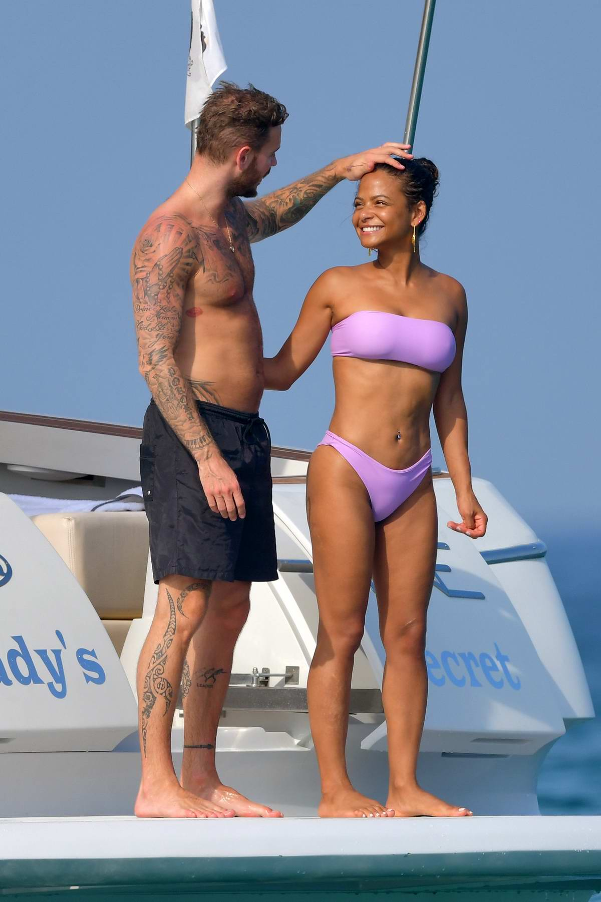 Christina Milian wears a purple bikini on a yacht while on vacation with Matt Pokora in Saint-Tropez, France