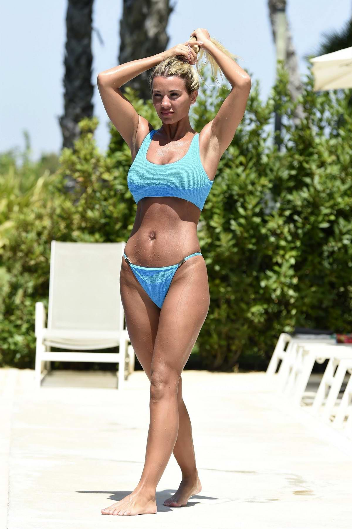 Christine McGuinness beats the heat in a blue bikini as she takes a dip in the pool while on holiday in Spain