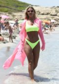 Christine McGuinness wears neon green bikini as she spends a day at the beach while on holiday in Spain