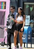 Cindy Kimberly wore a cropped tank top and short shorts as she stepped out with Zack Bia and his new girlfriend in Los Angeles