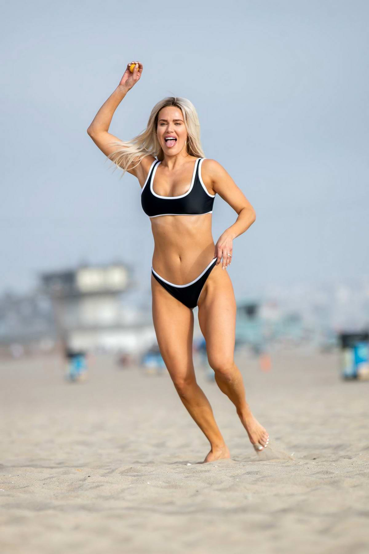 CJ 'Lana' Perry shows off her beach body in a black bikini while enjoying a day at Venice Beach, California