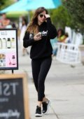 Dakota Johnson sports a black hoodie with matching leggings as she leaves a hot yoga class in Los Angeles