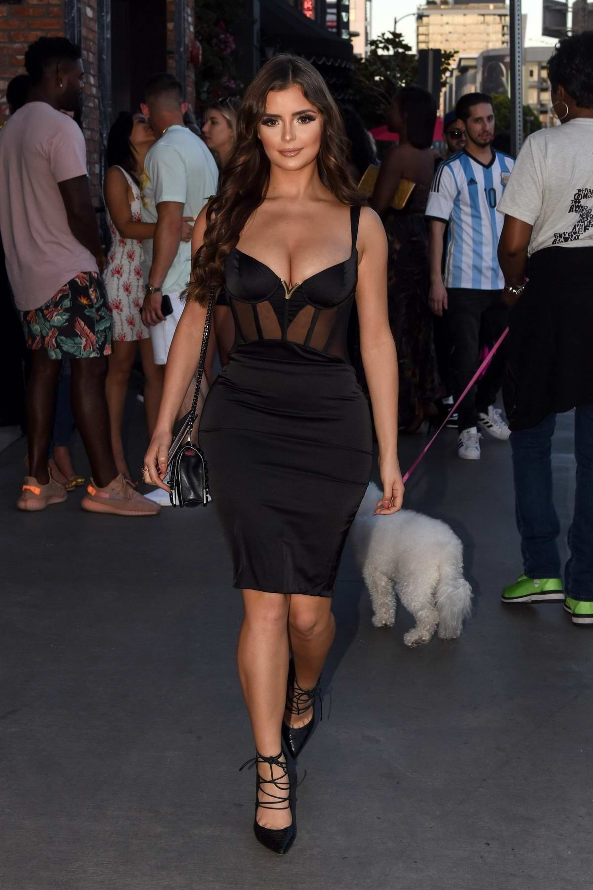 Demi Rose stuns in a plunging black dress as she arrives for a dinner event at TAO in Los Angeles