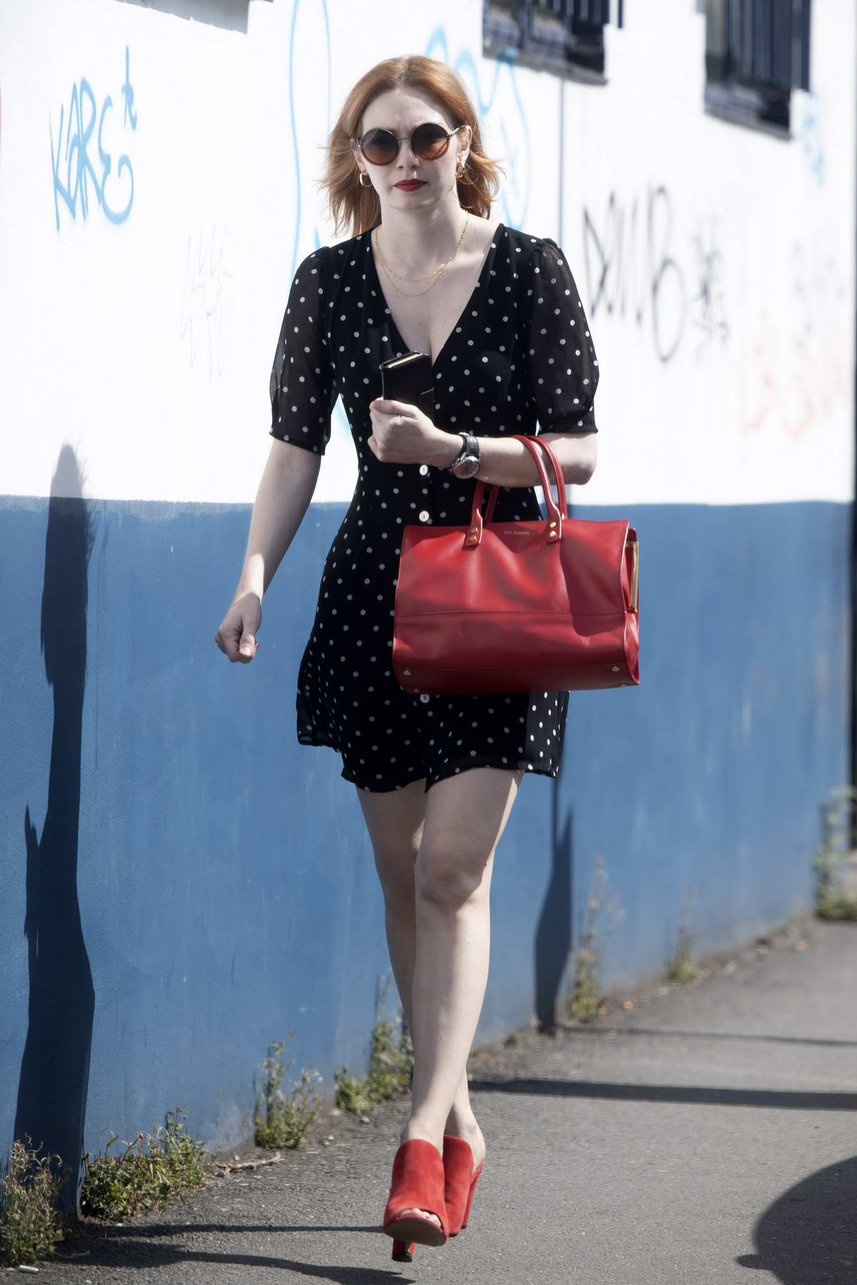 Eleanor Tomlinson debuts a new hair style as she walks to her local train station in London, UK