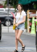 Elizabeth Olsen sports white tee and denim shorts while shopping groceries at Whole Foods with Robbie Arnett in Los Angeles