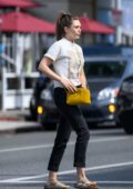 Elizabeth Olsen stops to grab some breakfast and coffee from a local eatery in Los Angeles