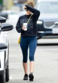 Elizabeth Olsen wears a navy sweatshirt and blue leggings for a coffee run to Alfred's in Studio City, Los Angeles