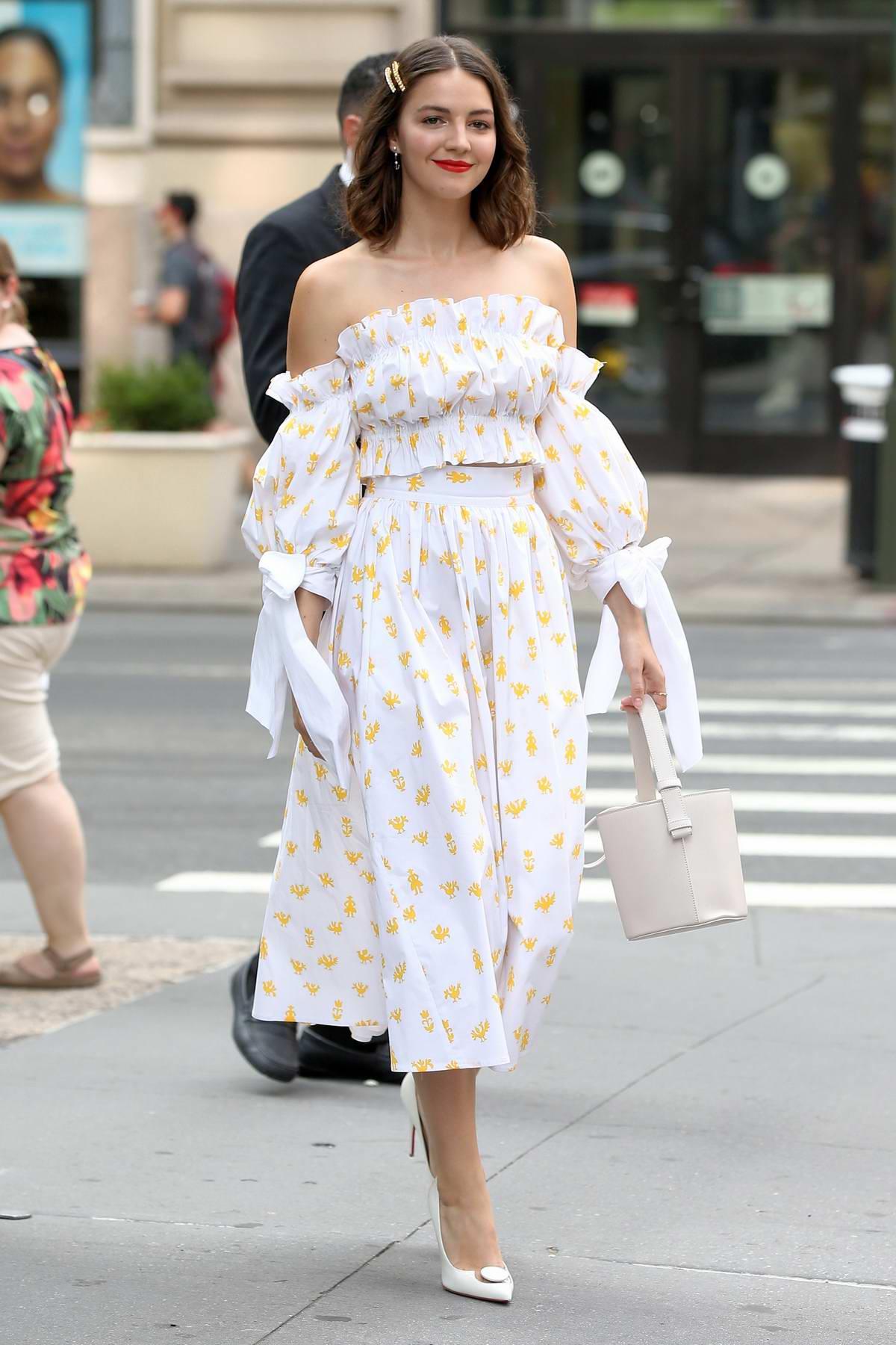 Ella Hunt looks elegant in white as she arrives at Build Studio in New York City