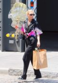 Elsa Hosk keeps it fashionable in a Prada shirt while out for some flower shopping in New York City