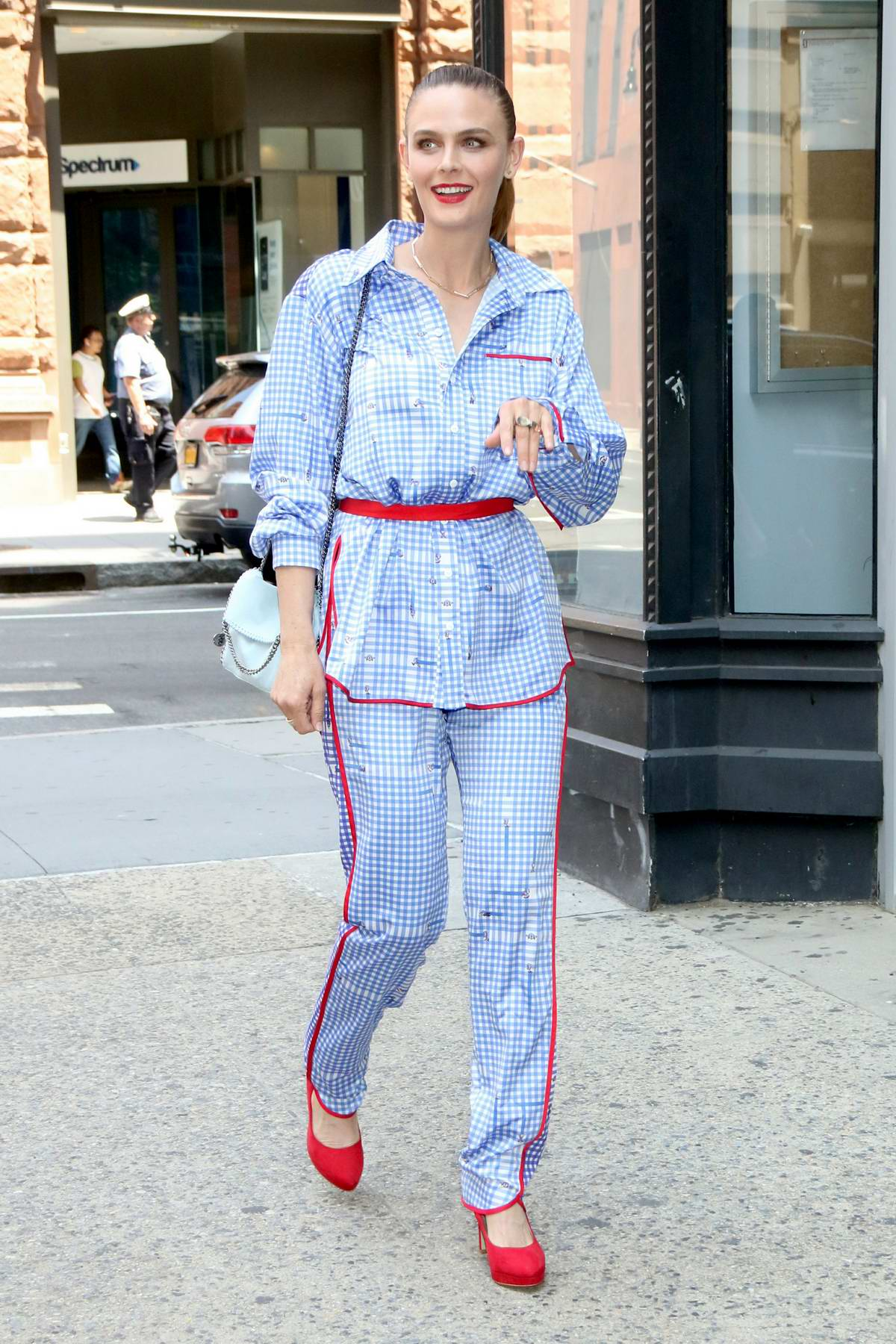 Emily Deschanel looks pretty in a blue checkered jumpsuit while visiting Build Series in New York City