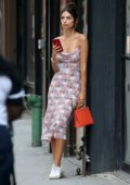 Emily Ratajkowski looks great in a printed dress paired with white sneakers while out in New York City