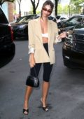 Emily Ratajkowski looks stylish in a tan blazer and white bra top with black capri pants while out New York City