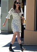Emma Roberts stepped out in a floral print white dress while running errands in Los Angeles