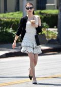 Emma Roberts steps out in a chic pleated polka dot dress for lunch with stylist Brit Elkin in Los Angeles