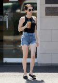 Emma Roberts wears a black tank top and denim shorts while out for an iced coffee in Los Feliz, California