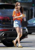 Emma Roberts wears a colorful shirt and denim shorts while out running errands and shopping groceries in Los Angeles