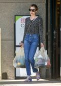 Emma Roberts wears a patterned shirt, jeans and Purple heels while shopping groceries at Gelson's Market in Los Feliz, California