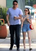 Emma Roberts wears striped top and denim shorts for an afternoon coffee run with Garrett Hedlund in Los Angeles