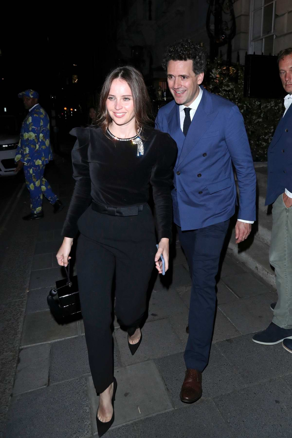 Felicity Jones and husband Charles Guard seen leaving Annabel's Members Club in London, UK