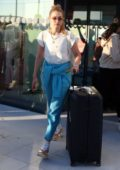 Gigi hadid dressed in white and blue as she touches down at the airport in Mykonos, Greece