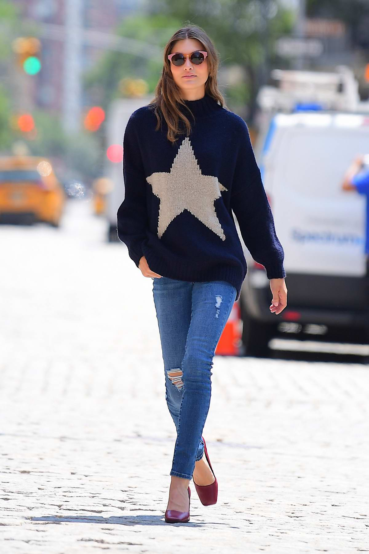 Grace Elizabeth battles the heat as she poses in woolen sweaters and leather jackets for a photoshoot in New York City