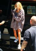 Hailey Baldwin dons an oversized plaid shirt, bra top, and shorts as she hits the gym in Los Angeles