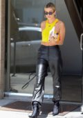 Hailey Baldwin steps out for business meeting rocking vibrant 'Off-White' tank and leather pants in Los Angeles