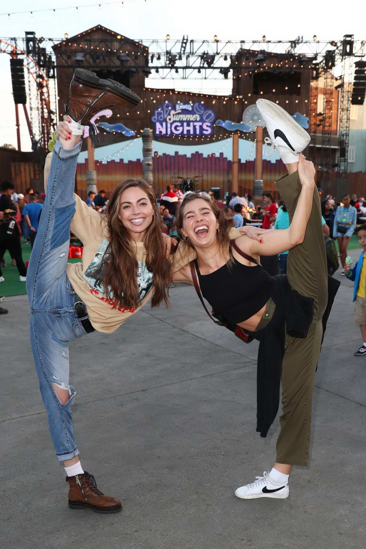 Haley Lu Richardson and Caitlin Carver enjoy a day out with friends at Knott's Summer Nights in Buena Park, California