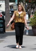 Hilary Duff looks lovely in a yellow top as she leaves a nail salon ahead of the 4th of July weekend in Studio City, Los Angeles