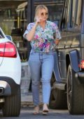 Hilary Duff steps out for dinner in a colorful floral print shirt and jeans in Studio City, Los Angeles