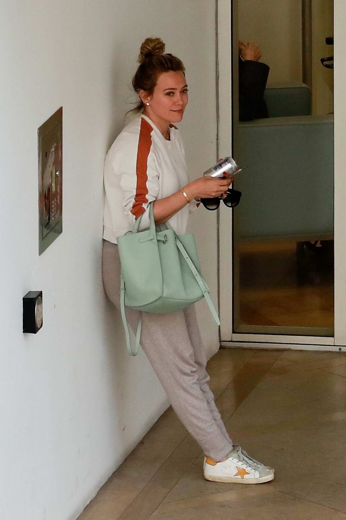 Hilary Duff waits at the valet for her car after a trip to a medical building in Beverly Hills, Los Angeles