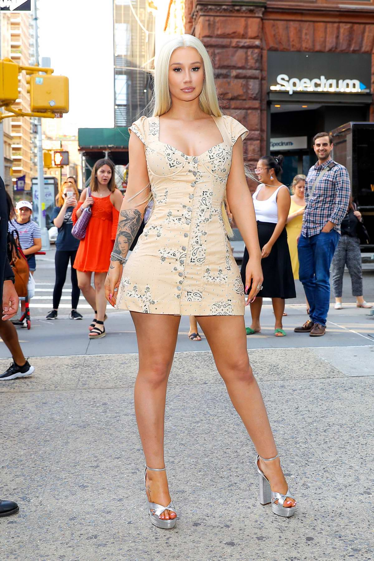 Iggy Azalea strikes a pose in a low-cut minidress as she arrives at the AOL Build Studios in New York City