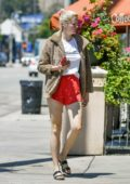 Ireland Baldwin shows off her long legs in bright red shorts while out in Los Angeles