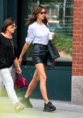 Irina Shayk looks stylish in a black leather skirt and white top while out shopping with her mom in New York City