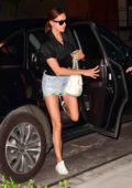 Irina Shayk seen wearing a black top and denim shorts as she arrives at her apartment in New York City