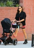Irina Shayk shows off her long legs as she takes her daughter for a stroll in New York City