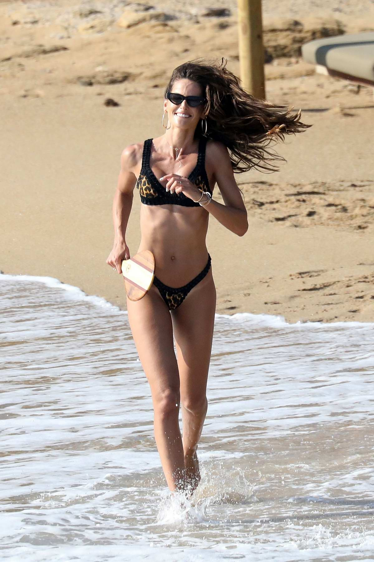 Izabel Goulart looks incredible in a bikini while enjoying some paddle ball with Kevin Trapp at the beach in Mykonos, Greece
