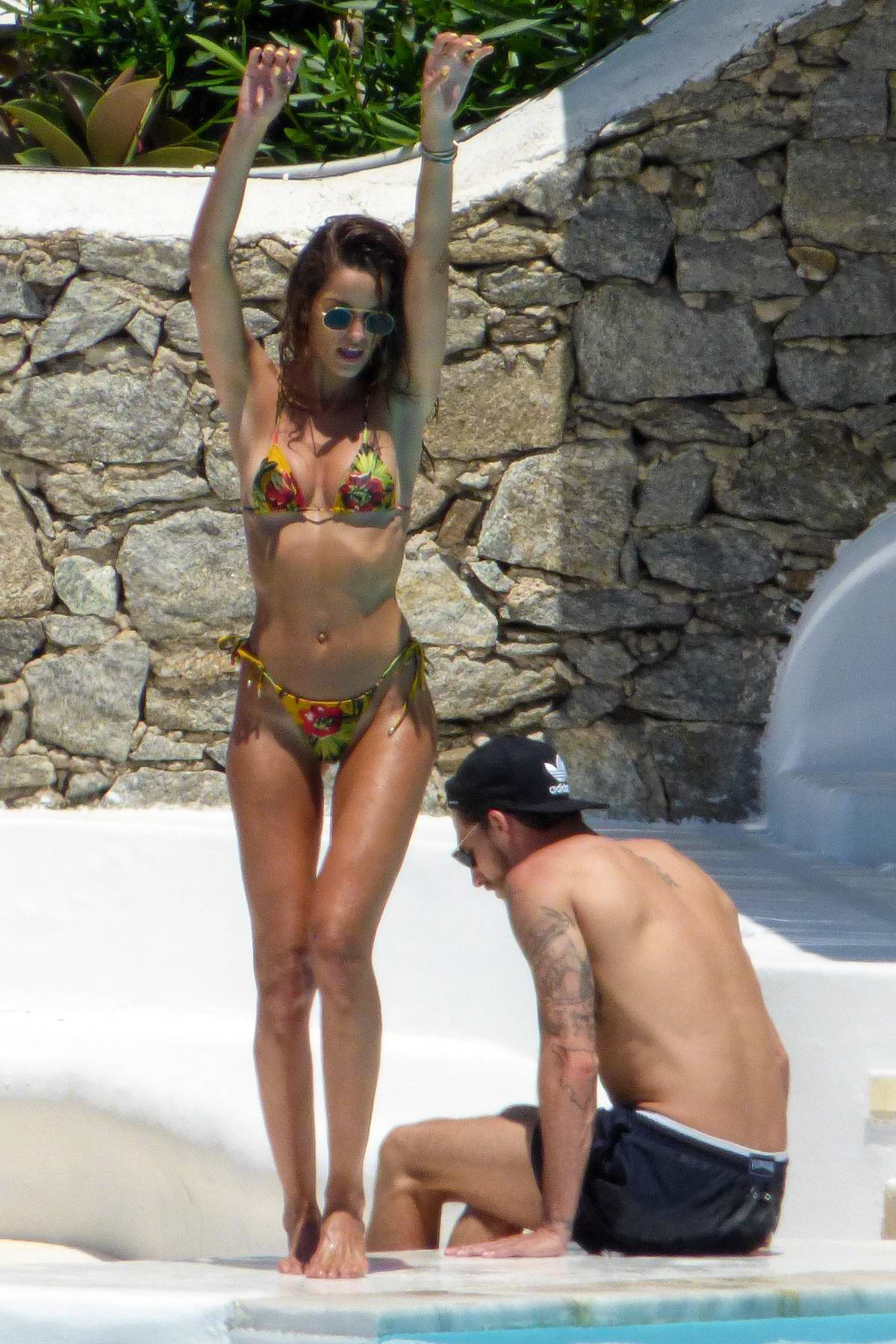 Izabel Goulart soaks up the sun in a floral print bikini while relaxing by the pool with Kevin Trapp in Mykonos, Greece