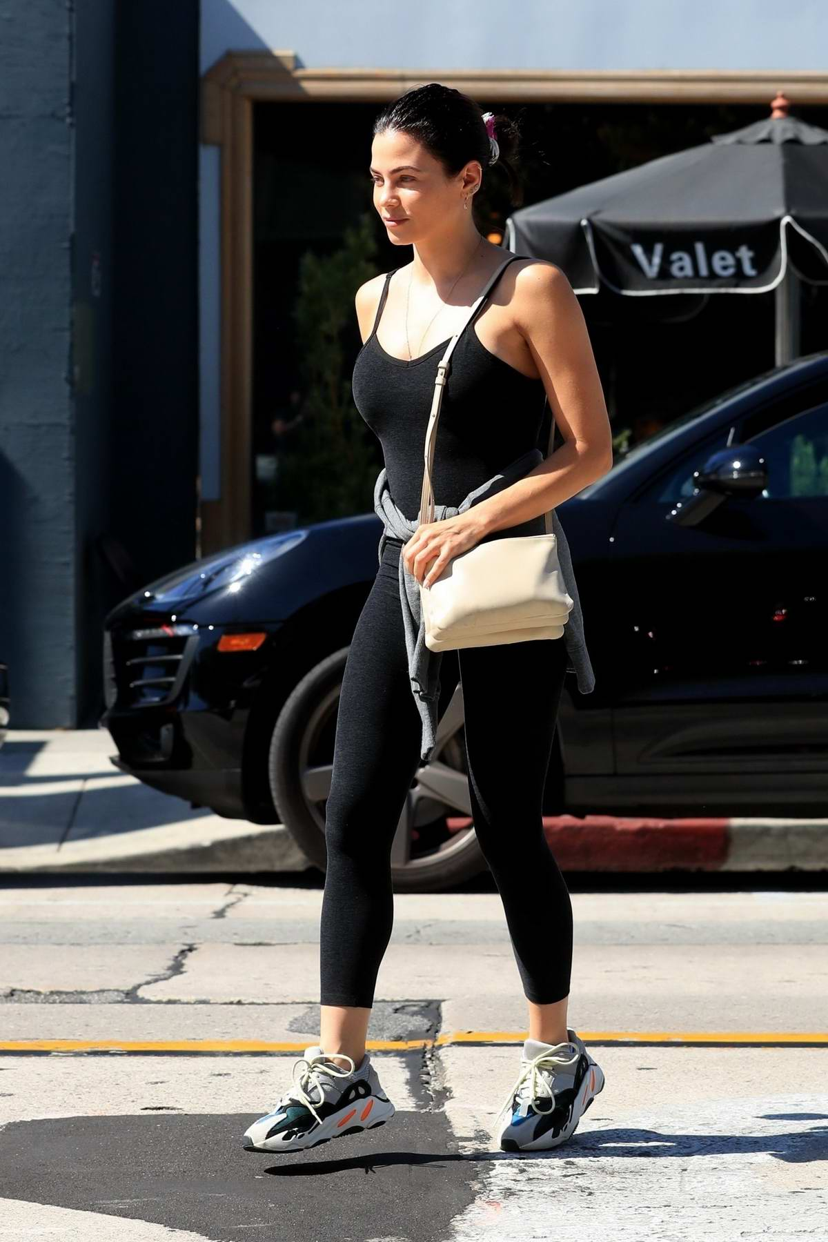 Jenna Dewan shows off her fit figure in dark leggings and a matching tank top as she leaves Urth Caffe in Los Angeles