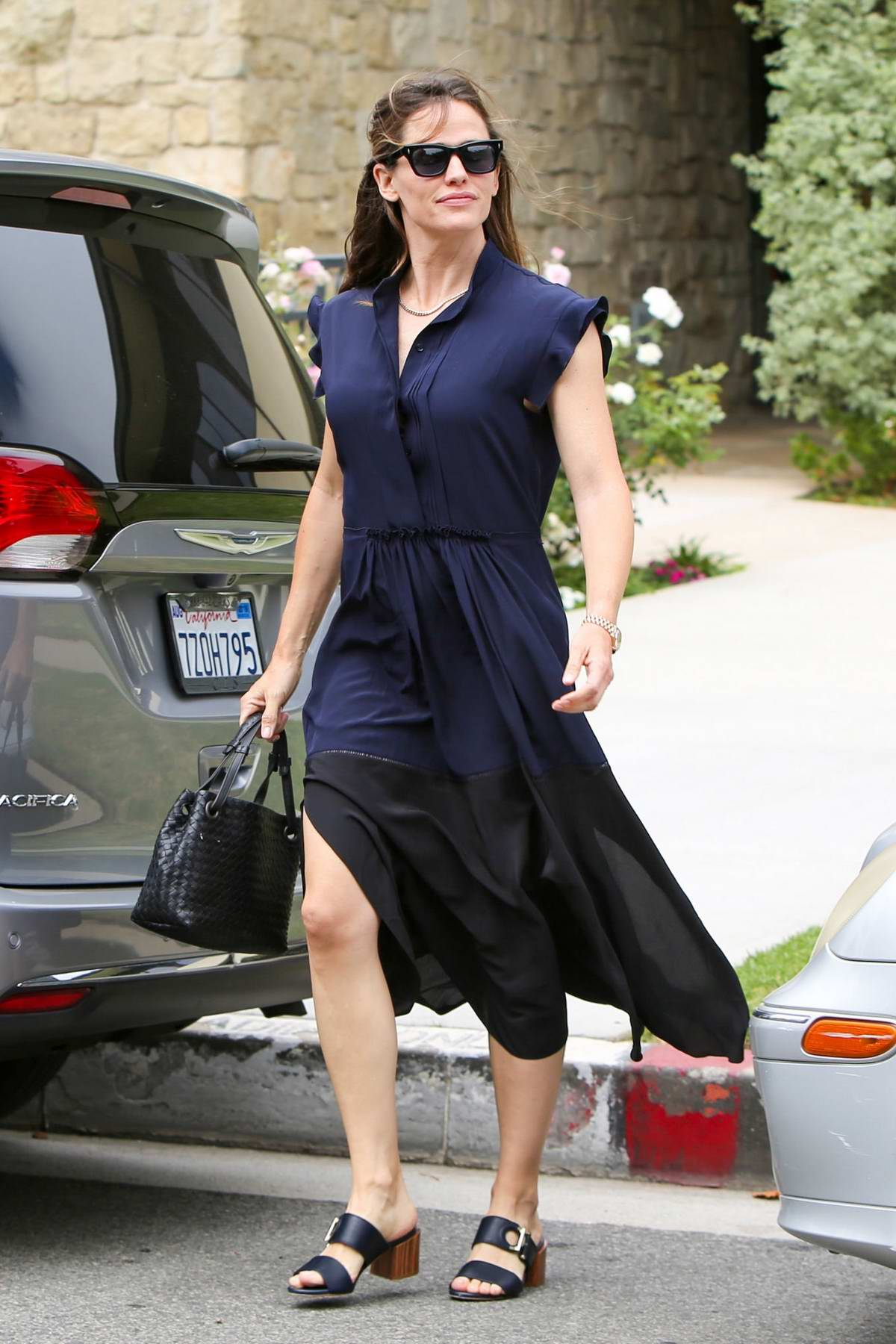 Jennifer Garner looks lovely in a navy blue dress while attending Sunday church service in Los Angeles
