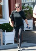 Jennifer Garner sports a black top and grey leggings as she leaves Malibu Country Mart in Brentwood, Los Angeles