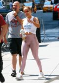 Jennifer Lopez sports a knotted tank top and shiny pink leggings as she hits the gym with Alex Rodriguez in New York City