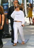 Jennifer Lopez waves and blows kisses as she leaves her apartment in New York City