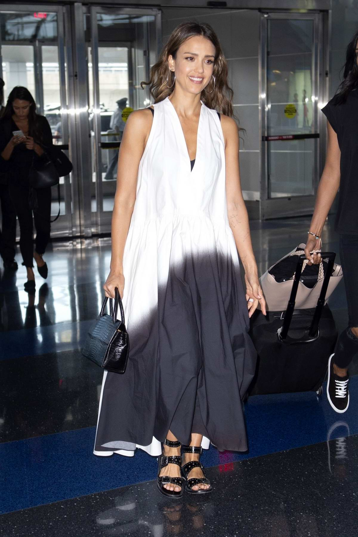 Jessica Alba looks stylish in a black and white ombre dress as she arrives at JFK Airport in New York City