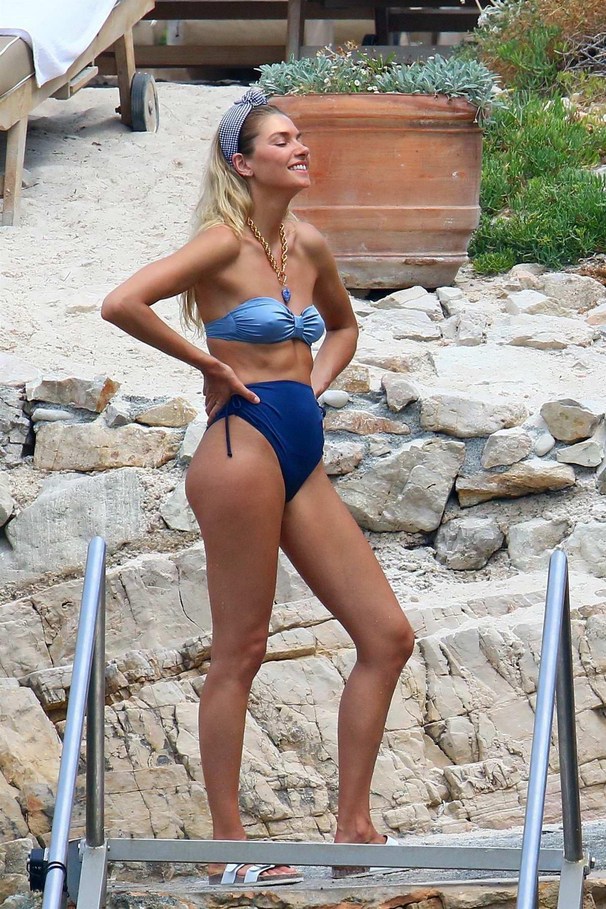 Jessica Hart poses in bikini during a beachwear photoshoot in Cannes, France