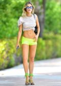 Joy Corrigan flaunts her amazing figure in neon green short shorts and crop top while out in Miami Beach, Florida