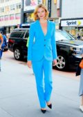 Karlie Kloss dazzles in a blue suit while attending Carolina Herrera event at Macy's in New York City