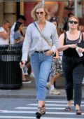 Karlie Koss wears a striped shirt and jeans while she walks to dinner in Soho, New York City