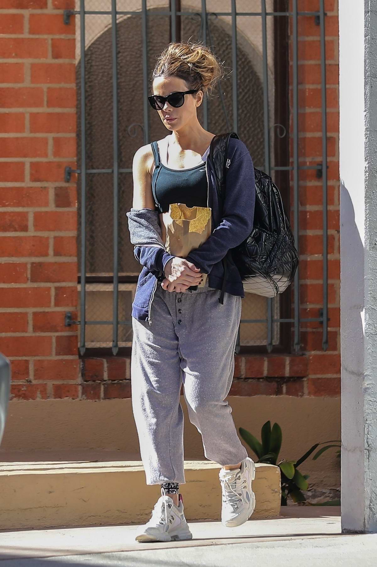 Kate Beckinsale visits a dentist office after her daily workout in Beverly Hills, Los Angeles