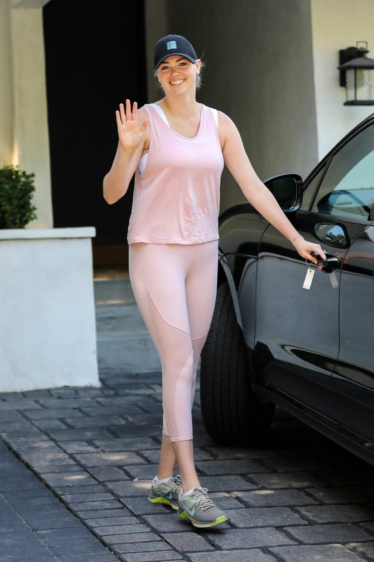 Kate Upton is all smiles while leaving a workout session donning a pink tank and matching leggings in Santa Monica, California